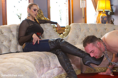 dominatrix in jeans footworship